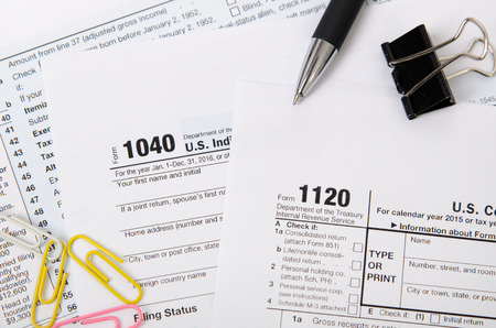 Us Tax Form 1040 1120 On Desk In Office Stock Photo Picture And