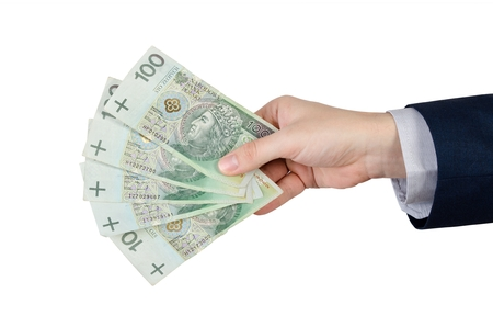 zloty: Range of Polish banknotes in hand. polish money zloty pln hand currency isolated finance concept Stock Photo