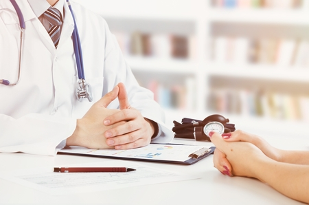 Doctor and patient medical consultation. doctor patient health care office desk stethoscope medical concept Banco de Imagens