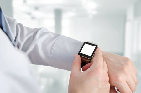 computer device: Man using smartwatch with e-mail notifier. smartwatch hand device notify computer internet message e-mail concept