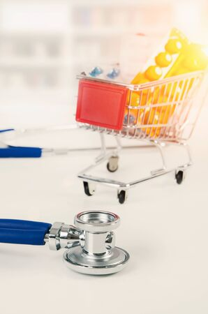Concept of drug prices. Set of drugs in the shopping trolley. pill drug medicine cost expensive trolley basket concept concept