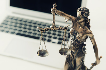 Justice and law concept in technology. justice computer themis scale weight courtroom laptop technology composition