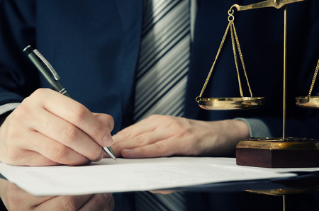 Lawyer working with agreement in office. man signing hand writing pen attorney concept