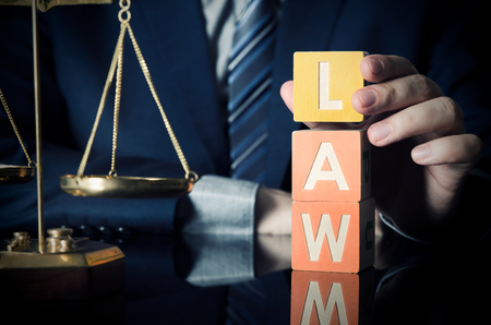 The lawyer puts LAW word. Attorney and lawyer concept. lawyer law justice judge scales courtroom blocks toy concept Stock Photo