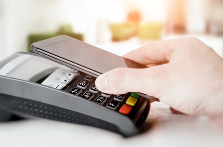 wireless terminals: Mobile payment with smart phone. payment nfc near field communication phone credit card concept Stock Photo