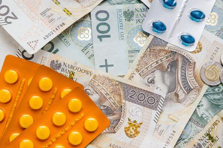 Pills and polish zloty bills. medicine pills health cost polish money zloty pln concept Stock Photo