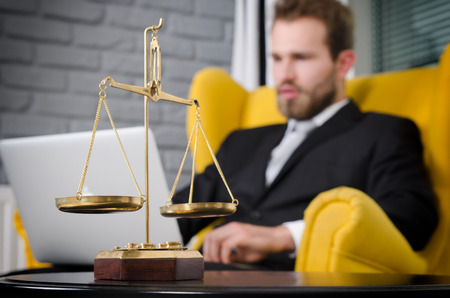 Weight scale of justice, lawyer in background. lawyer document agreement attorney scales authority background balance concept Stock Photo