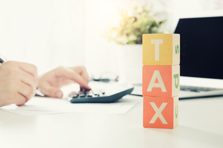Accountant calculates tax. Working in the office with calculator. business finance tax work calculate concept