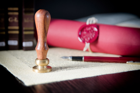 Law, attorney, notary public stamp and pen on desk. law will notary paper lawyer fountain pen seal concept Stok Fotoğraf