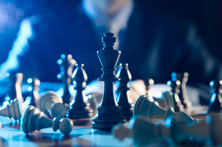 Chess financial business strategy concept. Team leader holding chess piece.
