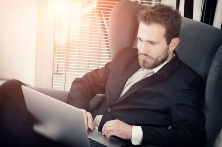Young business man working from home with laptop. home computer businessman laptop concept