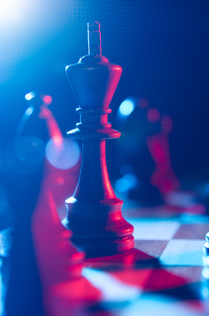 King on the chessboard. Vertical image background for print