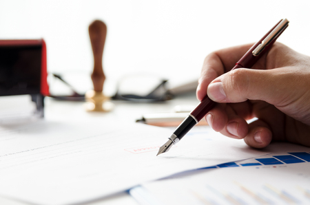 Notary signs legal contract. Businessman working in office. notary public lawyer desk attorney office law official concept Stock Photo