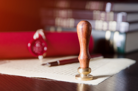 Notary public, attorney. Law concept with stamp in courtroom. law judge contract court legal trust legacy stamp concept Banque d'images