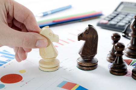 Financial business strategy. Chess on desk in office concept.