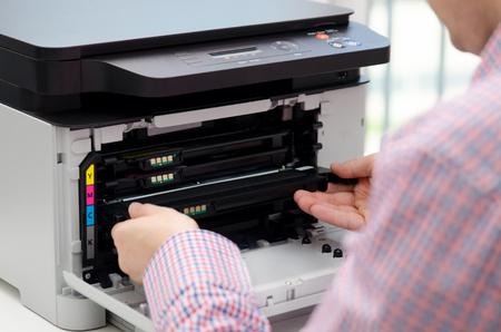 Man replacing toner in laser printer. toner printer cartridge print laser office supplies refill concept 스톡 콘텐츠