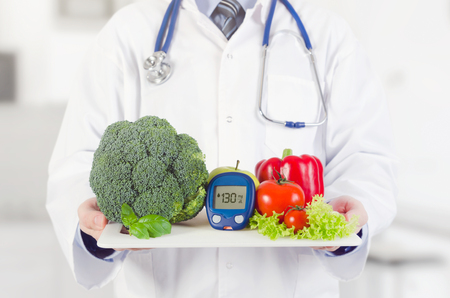 Doctor holding vegetables and fruits on a tray. Diet, nutrition, health care for diabetes concept