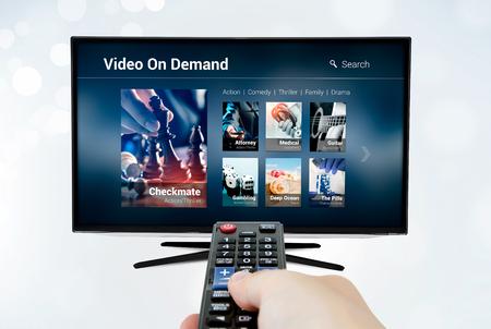 Video on demand VOD application or service on smart TV. Television multimedia stream internet concept Archivio Fotografico
