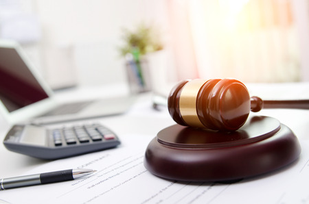 Wooden gavel at lawyer or attorney office. Law in technology, justice concept