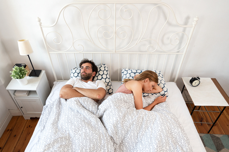 Couple bored with each other. Bad relations in a relationship. Stock Photo