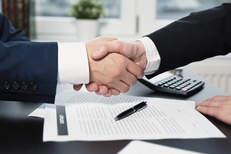 Business contract, agreement was signed by two business man shaking hands to each other Zdjęcie Seryjne