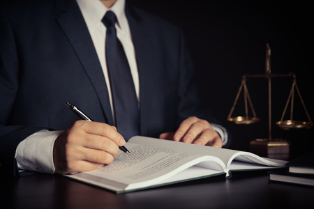 Weight scale of justice. Lawyer, attorney working in office. Consultant lawyer with law book. Zdjęcie Seryjne