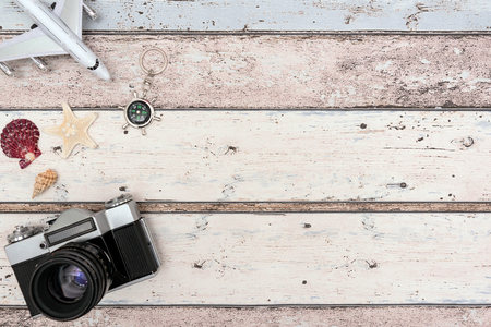 Summer Travel accessories on wooden background. Travel planning top view concept