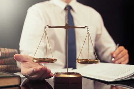 Weight scale of justice. Lawyer, attorney, working in office. Consultant lawyer with paperwork
