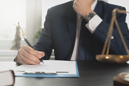 Lawyer working with documents. Justice and law, attorney, concept. Man signing contract papers Zdjęcie Seryjne