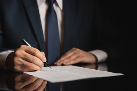Notary working in office. Lawyer, attorney, business person signing a contract, working in office