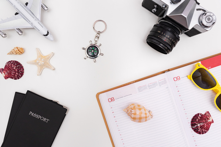 Summer Travel accessories on white background. Travel planning top view concept