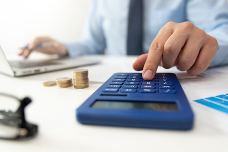 Man calculates the savings. Budget planning concept. Businessman working in the office
