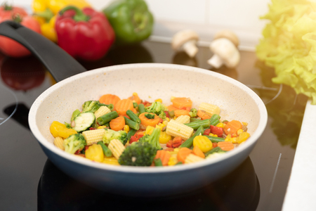 Fresh vegetables fried in a pan. Healthy nutrition concept. Healthy nutrition concept