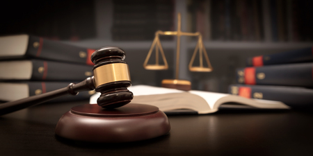 Judge gavel and scale in court. Library with lot of books in background Stock Photo