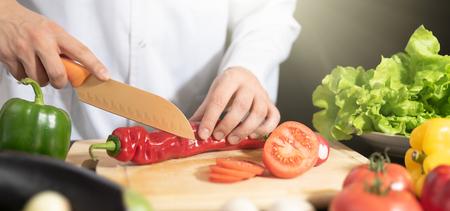 Chef prepares fresh vegetables. Cooking, healthy nutrition concept