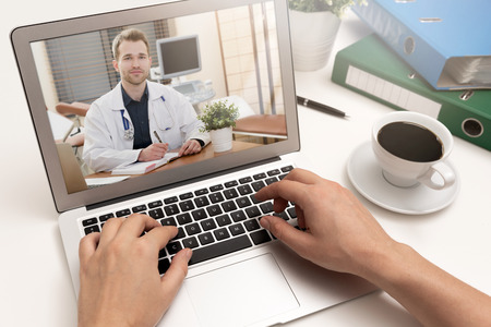 Doctor with a stethoscope on the computer laptop screen. Telemedicine or telehealth concept.
