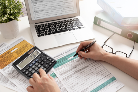 Polish individual income tax return. Accountant working with Polish tax forms