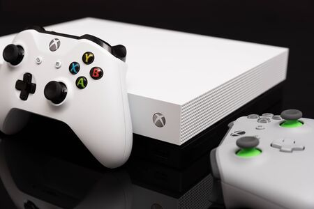 Wroclaw, Poland - JAN 08, 2019: Xbox One X is most powerful generation video gaming console Stock Photo - 128209263