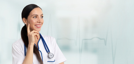 Portrait of a beautiful woman doctor on medical background. Web banner concept Zdjęcie Seryjne