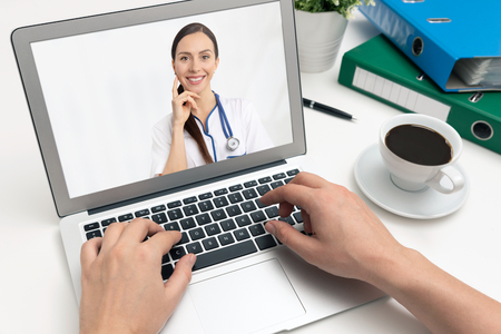 Doctor with a stethoscope on the laptop screen. Telemedicine or telehealth concept Zdjęcie Seryjne