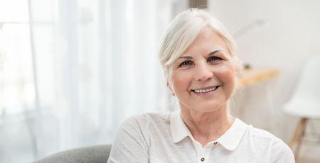 Portrait of smiling senior woman. Concept of lifestyle photo with copy space