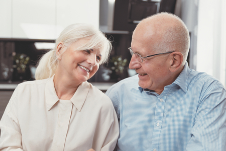 Happy senior couple laughing at home. Retirement senior couple lifestyle living concept Imagens