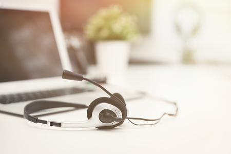 Headset in call center. Hotline support concept in office. Customer service support.