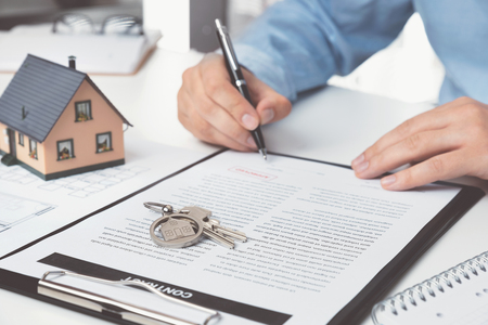 Real estate agent with home keys. Buying a new apartment concept