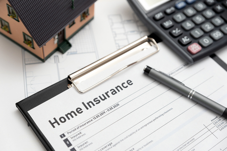 Home insurance form on the table. Assurance and home safety concept. Zdjęcie Seryjne