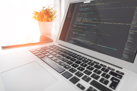 Programming code on laptop screen. Code language, website developer workplace at office.