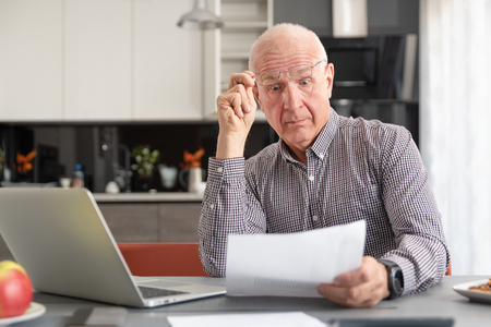 Senior man worried about bills and savings. Finances, savings, insurance concept Imagens