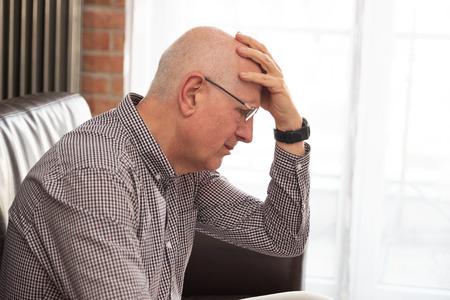 Older man has a headache. Senior healthcare concept