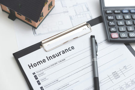Home insurance form on the table. Assurance and home safety concept. Zdjęcie Seryjne - 125165166