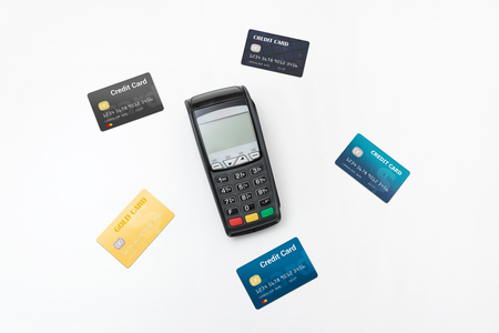 Payment terminal, credit card machine with some credit cards top view composition Zdjęcie Seryjne - 125165169
